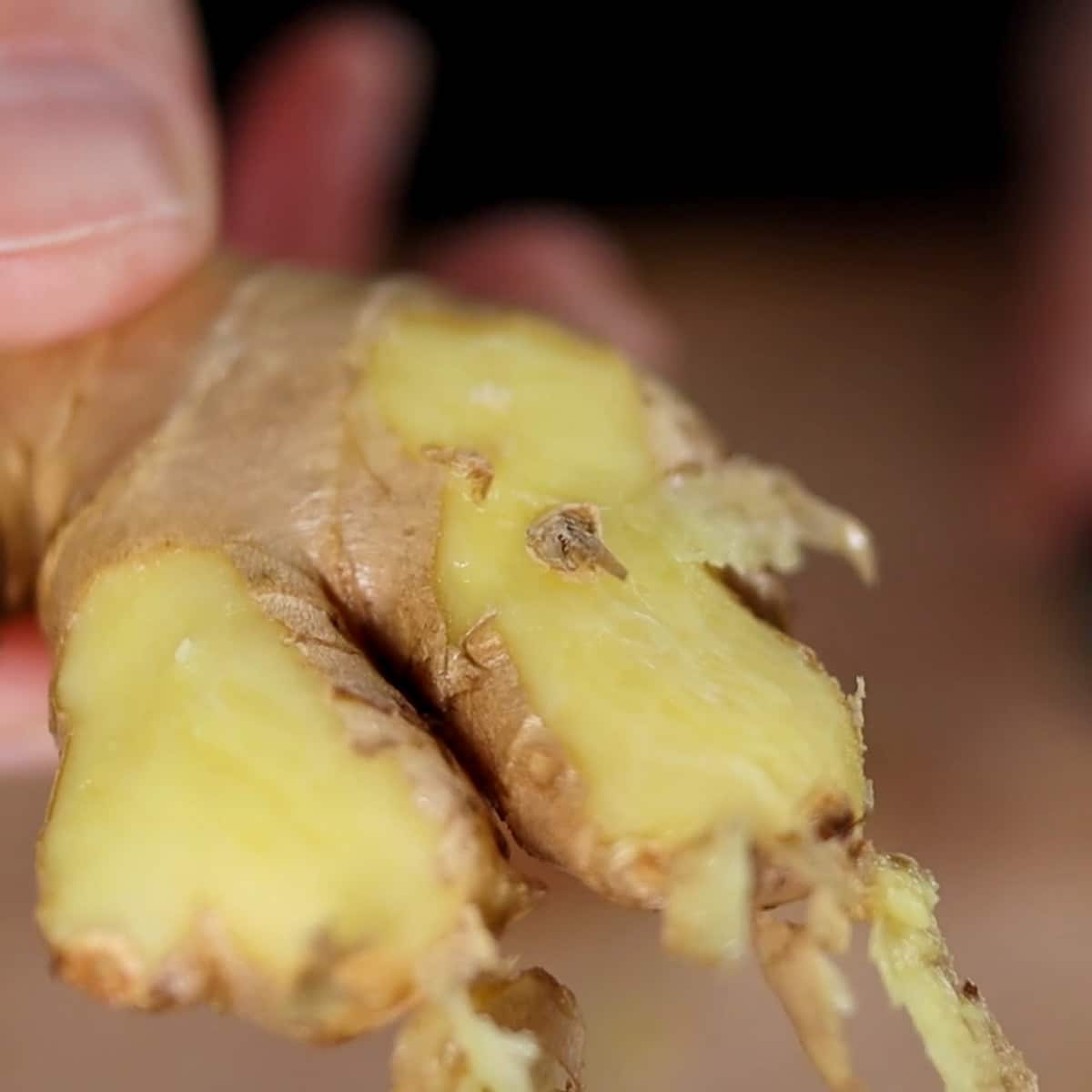 ginger half peeled with spoon