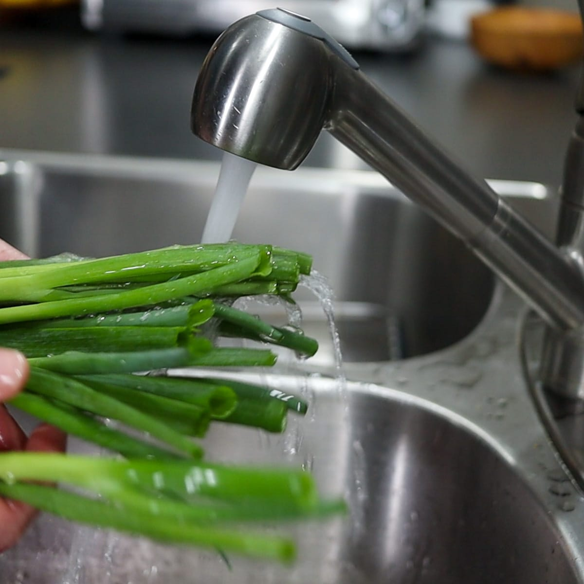 washing under a sink with cold water