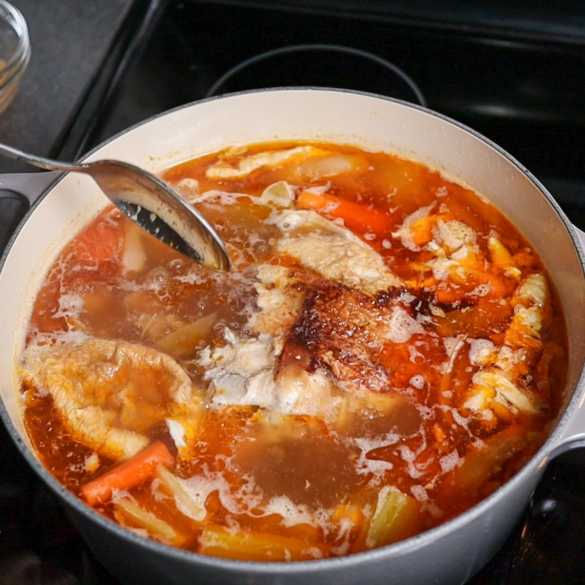 chicken in a pot becoming broth