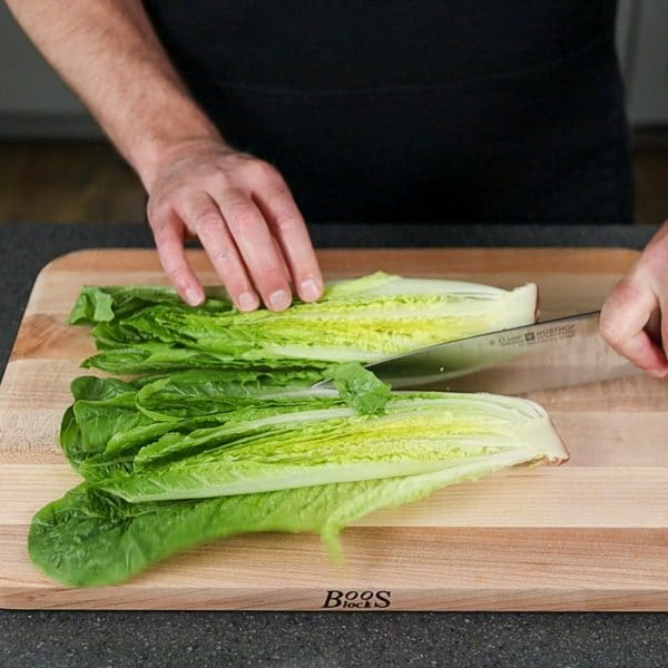Romaine lettuce being sliced the long way