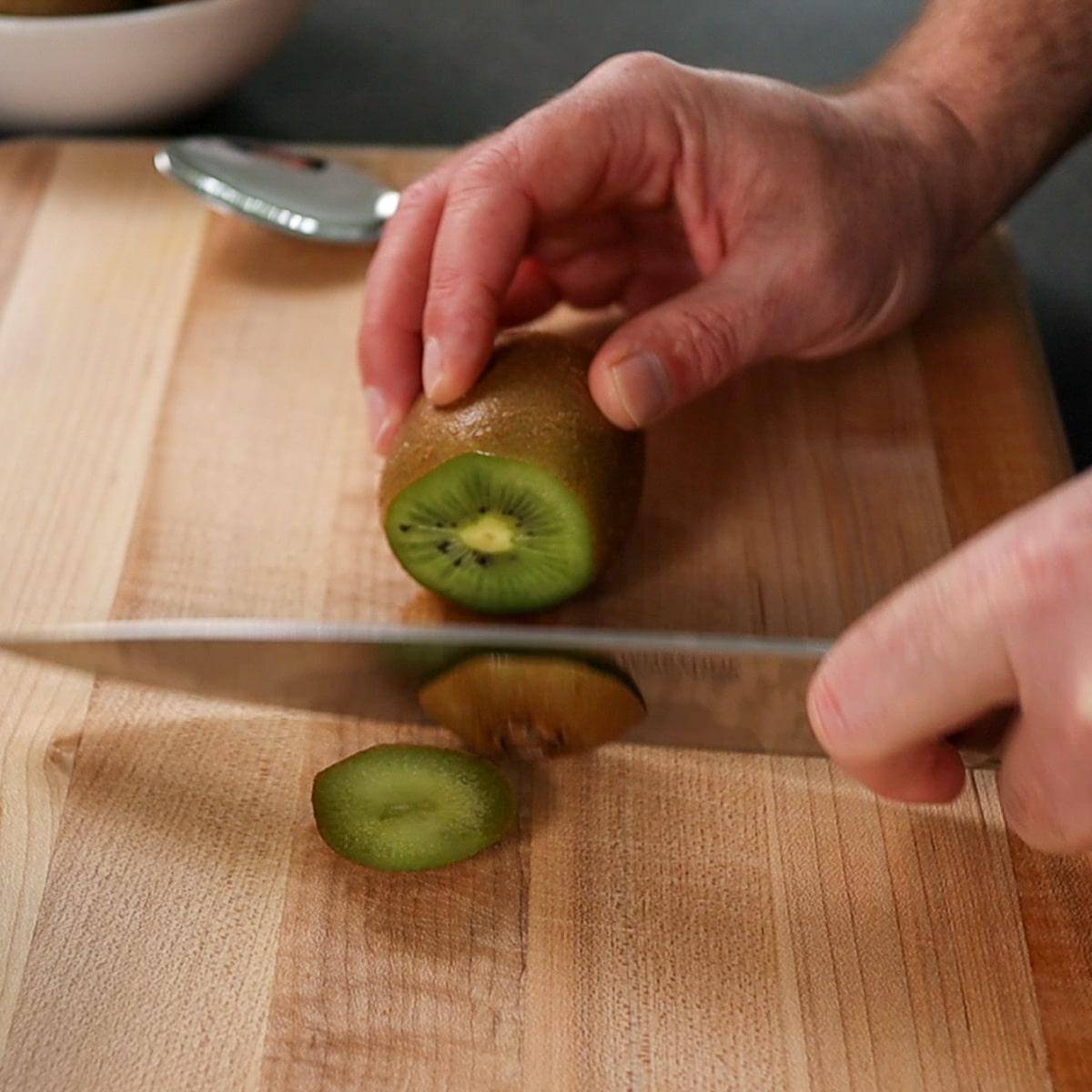 cutting ends off a kiwi fruit