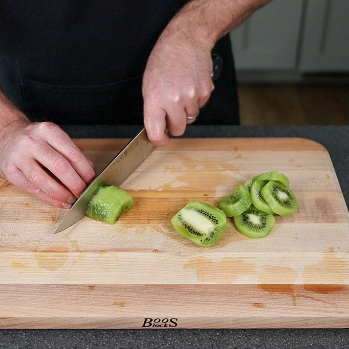 cutting half slices of kiwi fruit