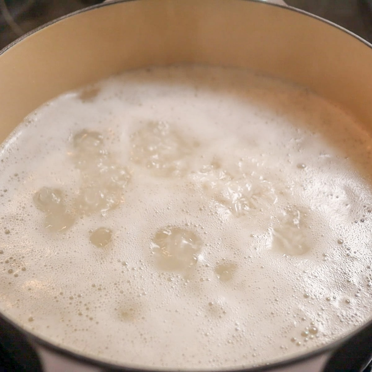 rice boiling in pot