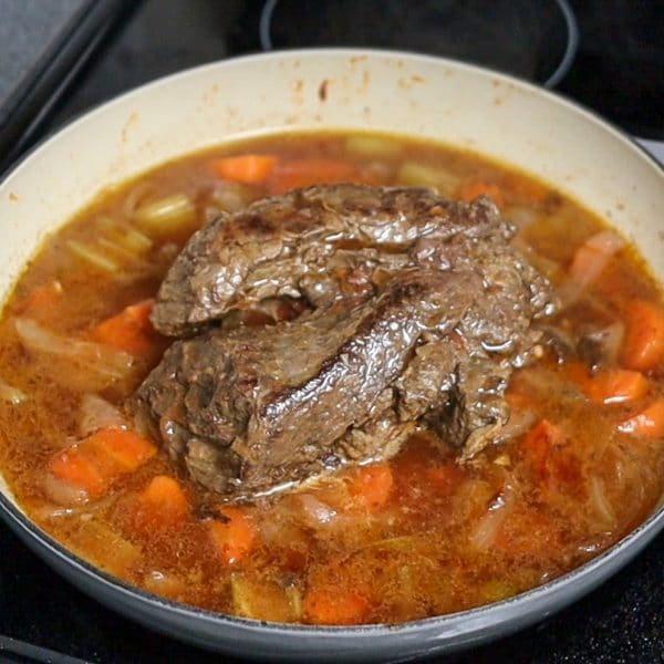 chuck roast being braised
