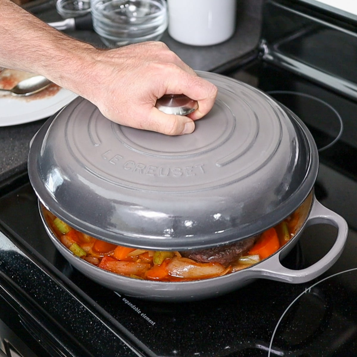 putting the lid on the pan