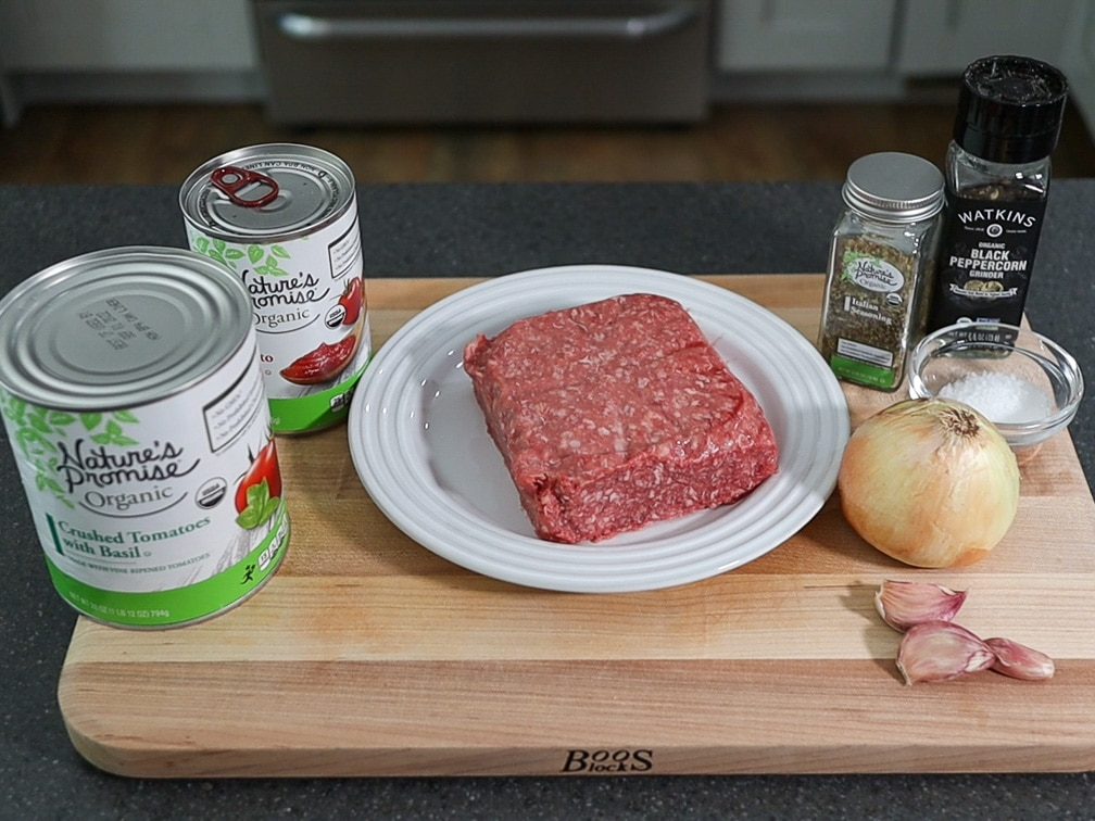 ingredients on a cutting board for a spaghetti meat sauce