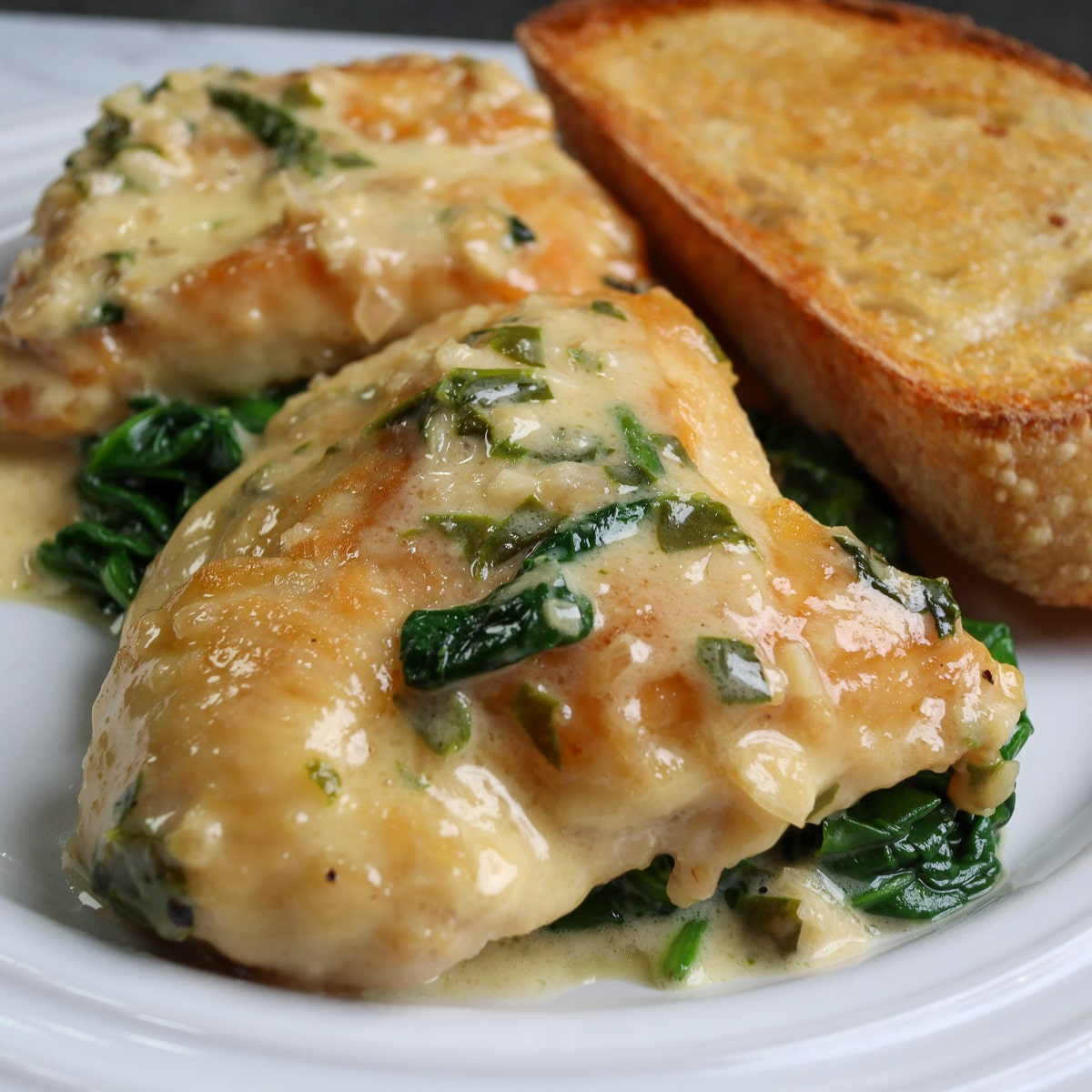 finished dish with the chicken florentine on a plate