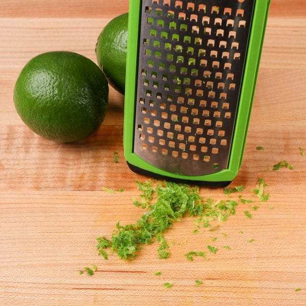 lime zest in front of a zester
