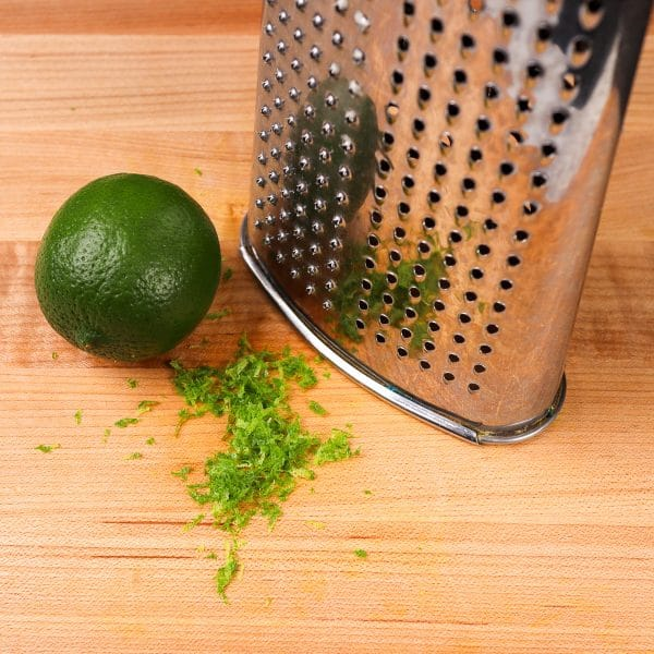 lime zest in front of a box grater