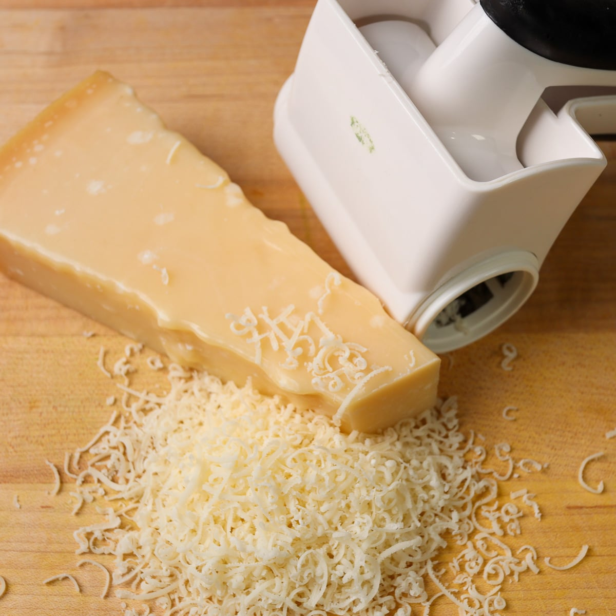 fresh grated parmesan cheese on a cutting board