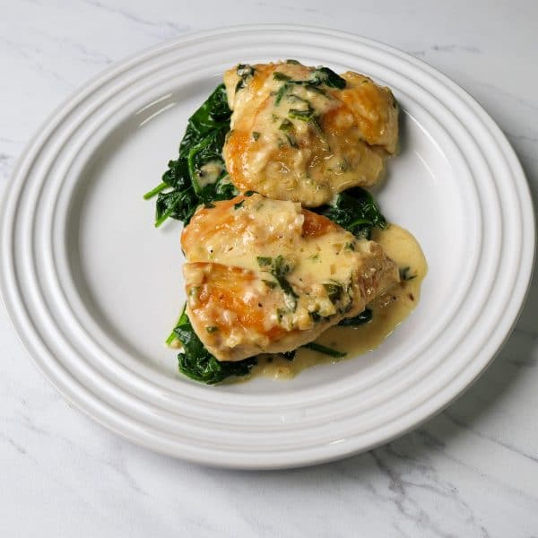 chicken florentine plated on a white plate