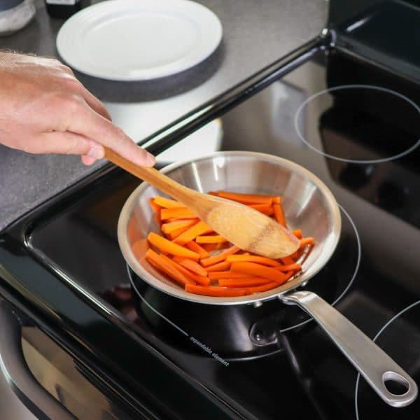 sauteing carrots in a pan