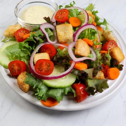up close picture of a garden salad on a plate