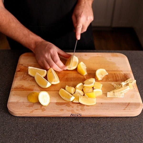 cutting lemons into wedges