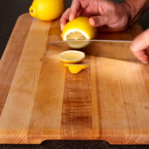 cutting ends of the lemons