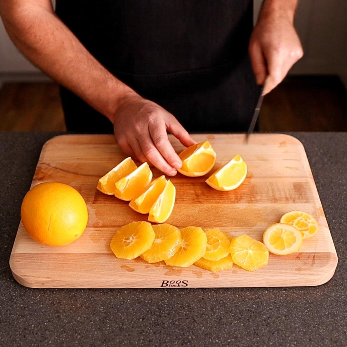 cutting oranges on a cutting board