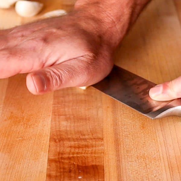 smushing the garlic clove