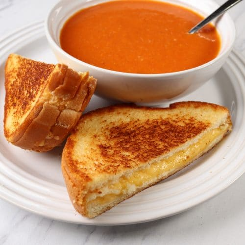 grilled cheese and tomato soup on a plate