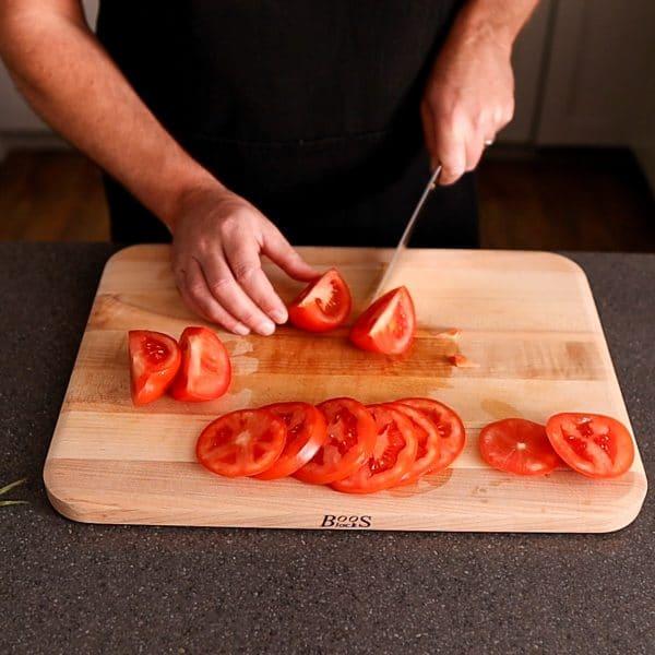 cutting tomato quarters