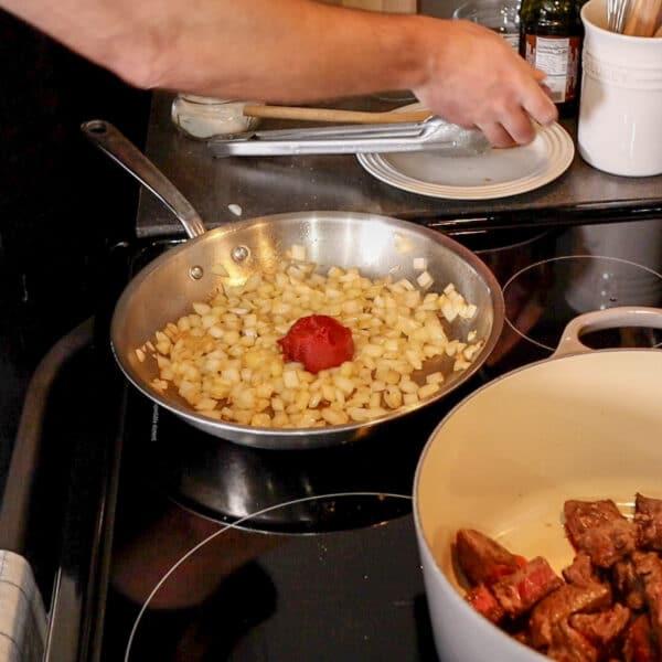 sauté onions tomato paste and garlic