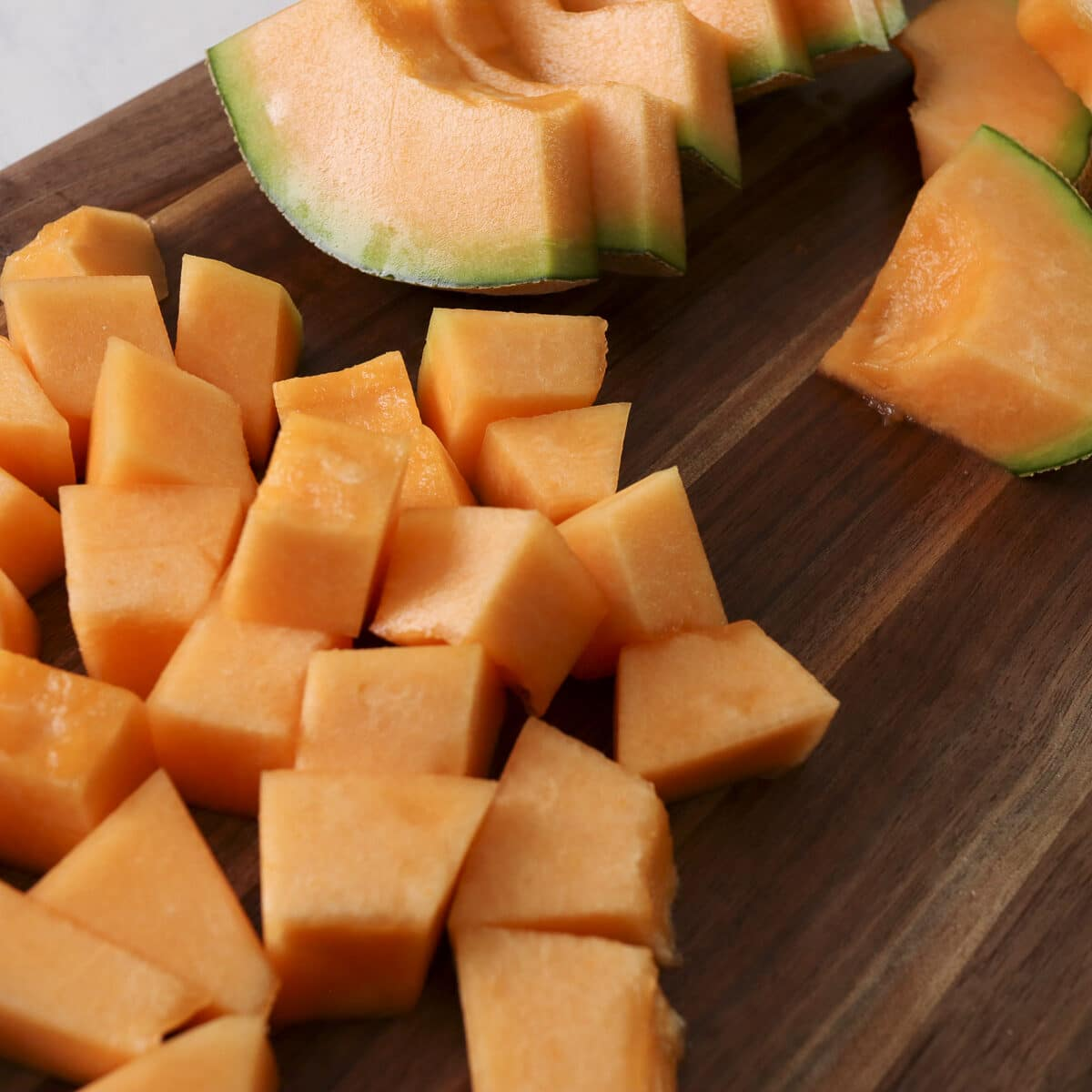 cut cantaloupe on a cutting board