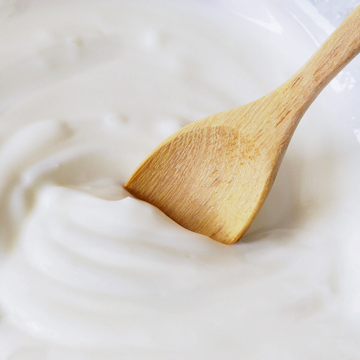 yogurt with a wooden spoon