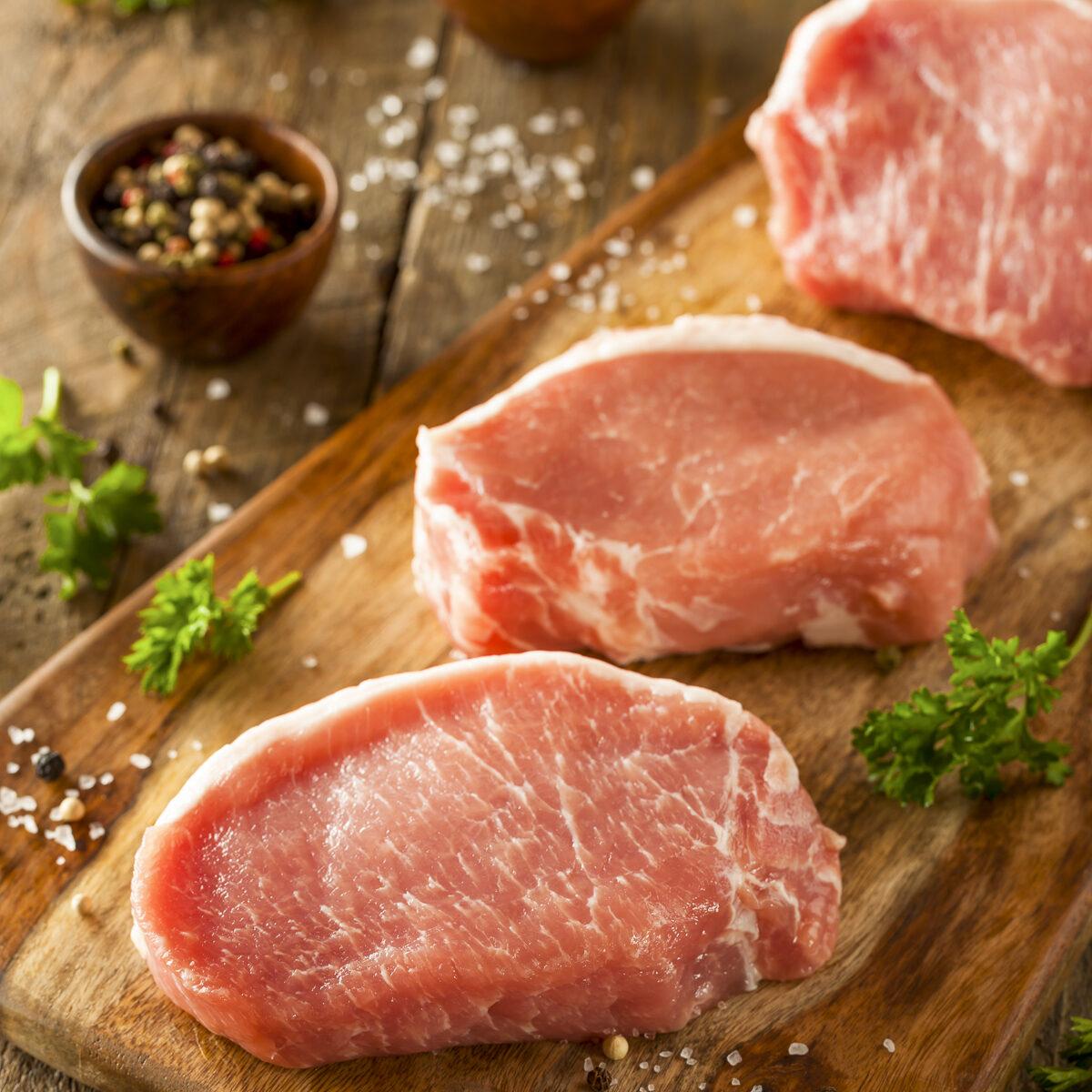 pork chops on a cutting board