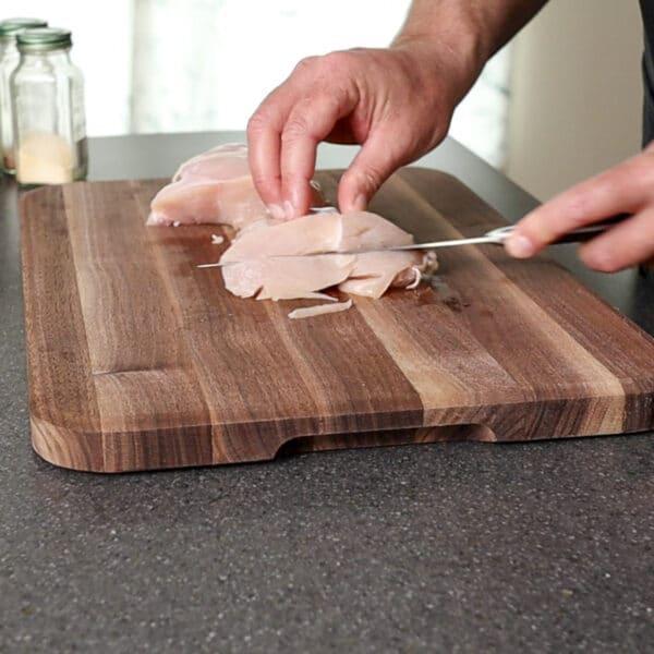 cutting chicken in half