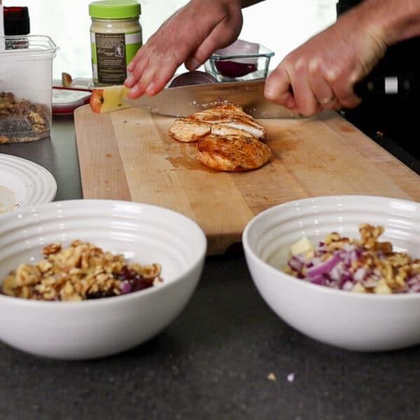 cutting up chicken for chicken salad