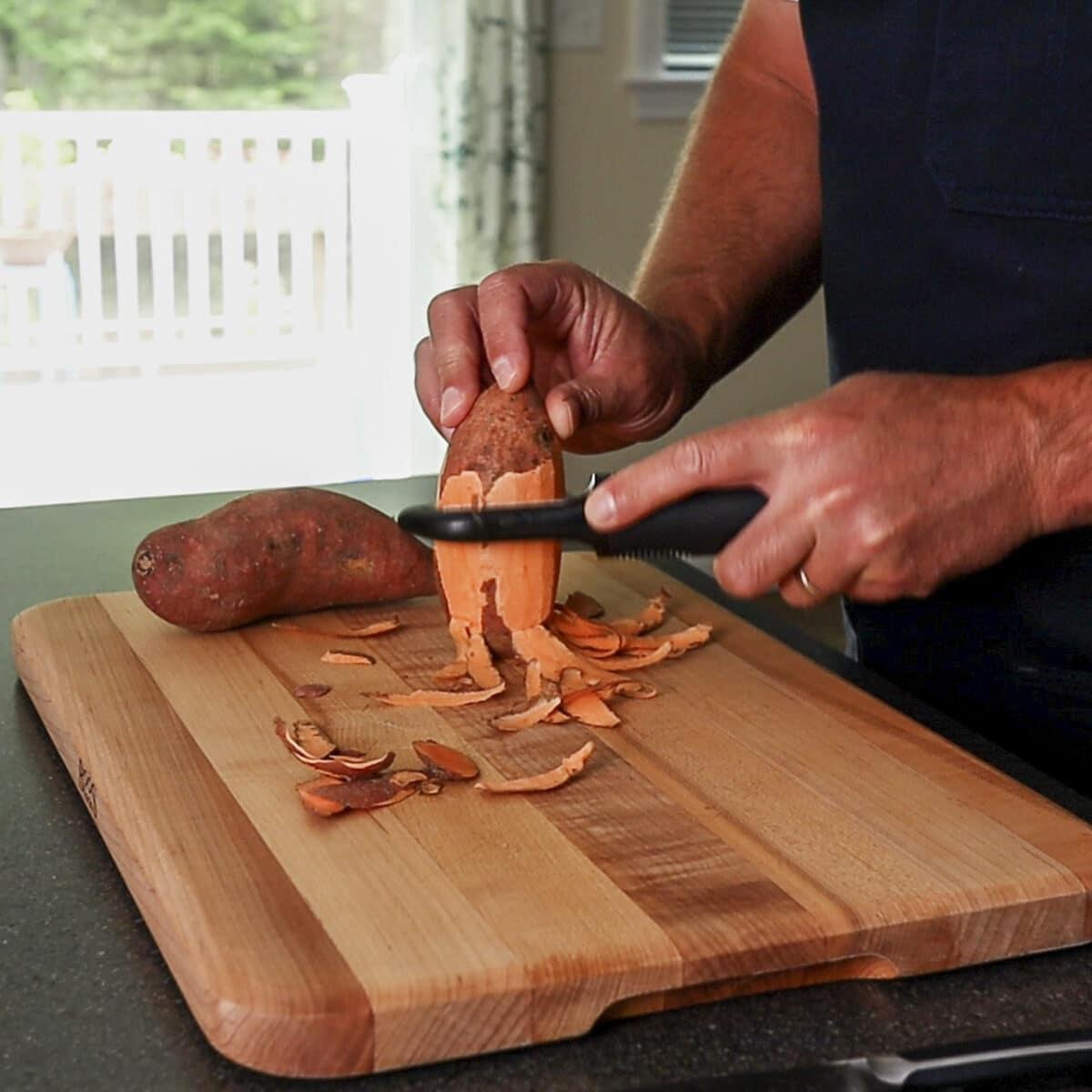 peeling a potato with a peeler