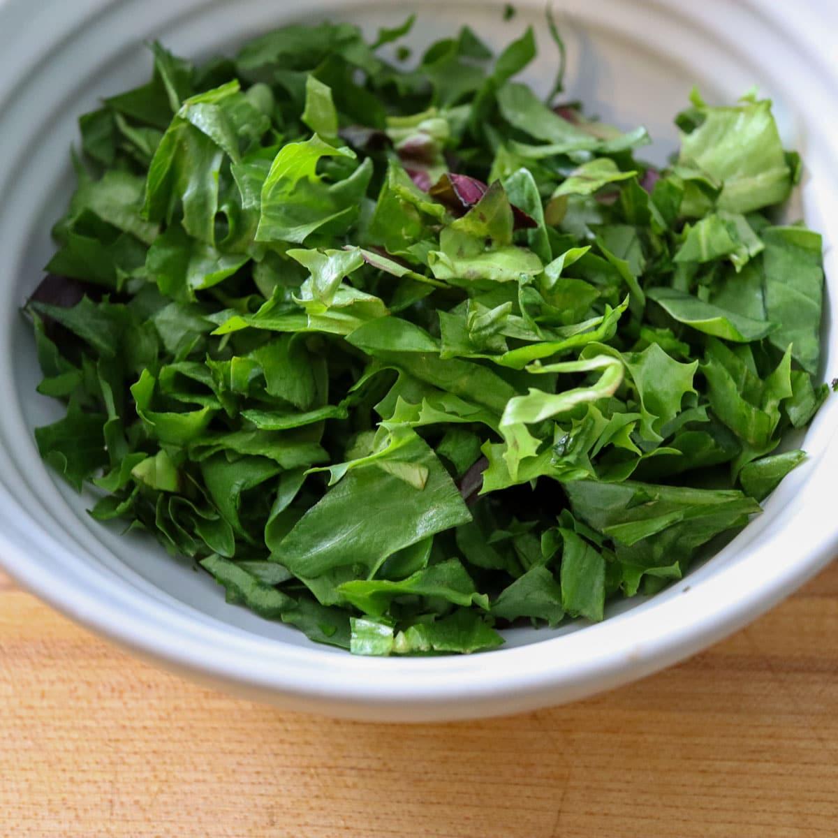 chopped green lettuce in a bowl