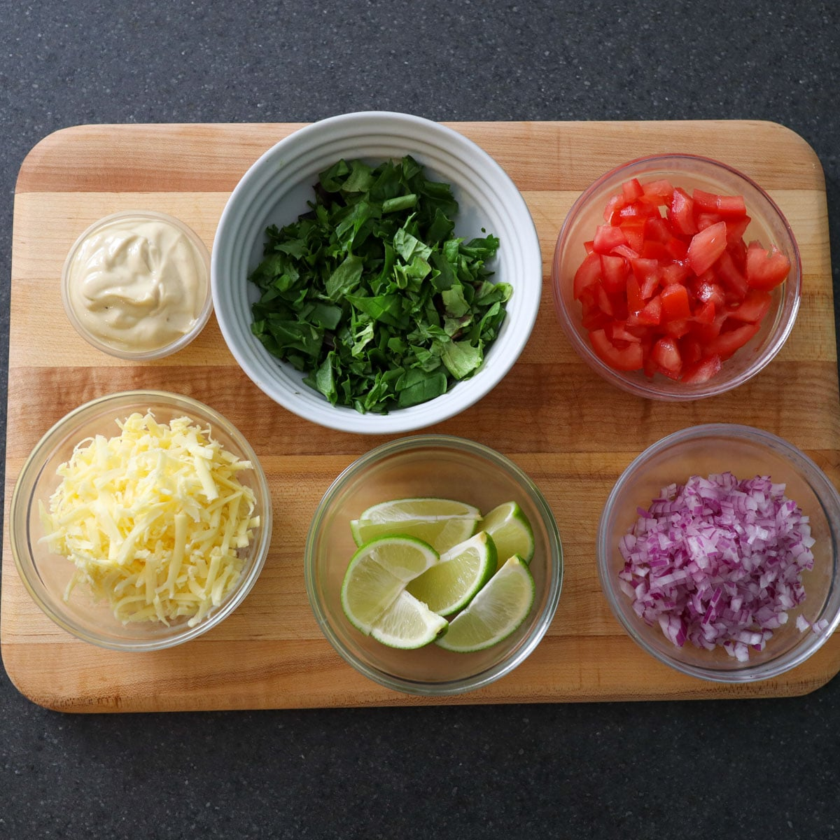 Grilled chicken tacos ingredients in bowls